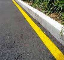 Solid yellow line on curb of road